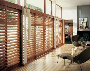 large windows with hardwood shutters