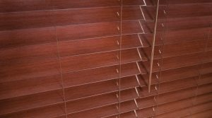 red-brown faux wood blinds